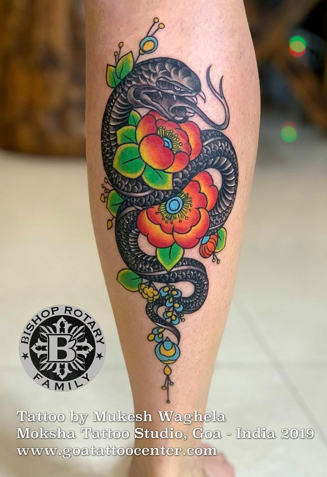 Snake with Flower Tattoo was done by Mukesh Waghela